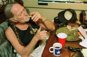 Willie-Nelson-takes-a-drag-off-a-joint-while-relaxing-at-his-home-in-Texas-2000s